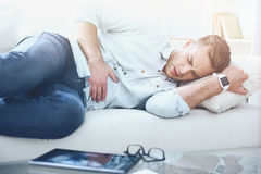 Young handsome man having stomach ache. Stock Images