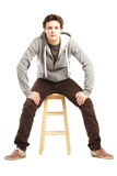 Young handsome man with hip style sitting Stock Photo