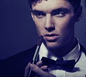 Young man and his first make-up Royalty Free Stock Photography