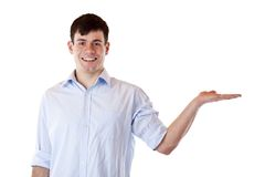 Young handsome man holding palm for presentation Royalty Free Stock Image