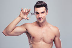 Young handsome man holding scissors Royalty Free Stock Photos