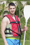 Young handsome man with inflatable vest going to kayaking Stock Photo