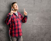 Young handsome man isolated over wall background stock images