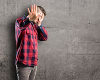 Young handsome man isolated over wall background royalty free stock image