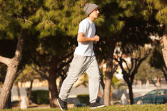 Young handsome man jogging in public park Stock Photography