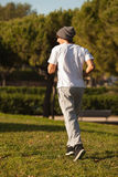 Young handsome man jogging in public park Royalty Free Stock Photography