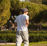 Young handsome man jogging in public park Royalty Free Stock Photos