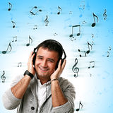 Young handsome man listening music Stock Photos