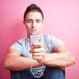 Young handsome man listening to the music Stock Images