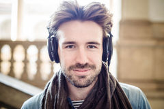 Young handsome man listening to music Stock Photo