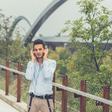 Young handsome man listening to music in an urban context Stock Photos