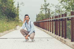 Young handsome man listening to music in an urban context Stock Photography