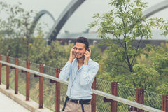 Young handsome man listening to music in an urban context Royalty Free Stock Photo