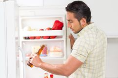 Young handsome man looking for food in the fridge Stock Photography