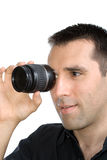 Young handsome man looking through lens Stock Images
