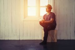 Young handsome man looking out his window at home in the room al Royalty Free Stock Photos