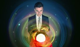 Man looking to the future of the word in a magic ball Royalty Free Stock Images
