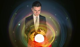 Man looking to the future of the word in a magic ball stock image