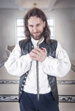 Young handsome man in medieval clothes with dagger Stock Photography