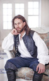 Young handsome man in medieval clothes Royalty Free Stock Photo