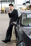 Young handsome man, model of fashion, with luxury cars royalty free stock photos