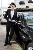 Young Handsome Man, Model Of Fashion, With Luxury Cars Royalty Free Stock Images