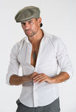 Young handsome man in modern cap Royalty Free Stock Photography