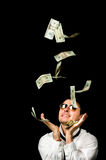 Young handsome man and Money falling. Young rich handsome man and Money falling stock photos