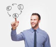Young handsome man with money icons Royalty Free Stock Photography