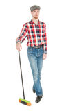 Young handsome man with mop isolated Royalty Free Stock Images