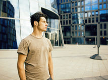 Young handsome man near business building, modern businessman concept Royalty Free Stock Image