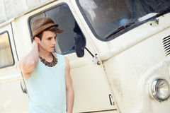 Young handsome man with an old van wearing sun hat Stock Photo
