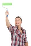 Young handsome man painting wall. Royalty Free Stock Image