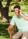Young handsome man phoning Stock Images