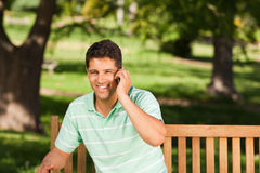 Young handsome man phoning Stock Photo
