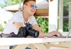 Attractive young man student using laptop outside stock photos