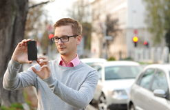 Young handsome man photographing Stock Photo