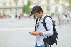 Young handsome man photographing with mobile smart phone Royalty Free Stock Photography
