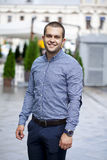 Young handsome man in in plaid shirt on the background of summer Royalty Free Stock Images
