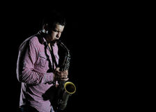 Young Handsome Man Playing Music On Saxophone Stock Photography