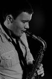 Young handsome man playing music on saxophone Royalty Free Stock Photography