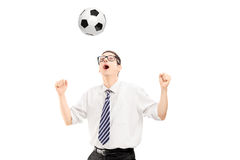 Young handsome man playing with a soccer ball Royalty Free Stock Photography