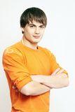 Young handsome man portrait in orange Stock Photography