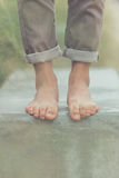 Young handsome man posing bare feet Stock Photography