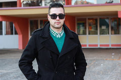 Young Handsome Man Posing in a Black Winter Coat Wearing Sunglas. Ses Stock Images