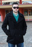 Young Handsome Man Posing in a Black Winter Coat Wearing Sunglas. Ses Royalty Free Stock Photo