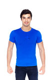 Young handsome man posing in blue t-shirt Stock Photography