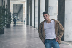 Young handsome man posing in the city streets Royalty Free Stock Photos