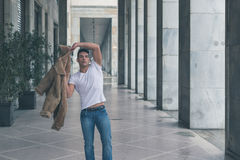 Young handsome man posing in the city streets Stock Images