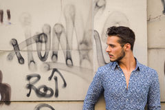 Young handsome man posing in the city streets Stock Photos